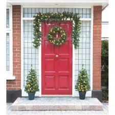 festive pre lit christmas door decoration set 4 piece