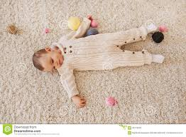 Baby Carpet Baby Lays On The White Shaggy Carpet Top View Stock Photo Image