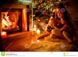 happy family by a fireplace on christmas stock photo image 44270512