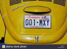 yellow volkswagen beetle royalty free number plate old vw beetle port townsend washington state usa