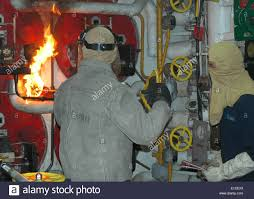 u s navy fireman trent miller lights the number two boiler