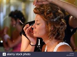 makeup artist in island a makeup artist apply makeup on a model before a a fashion show in