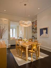 home design ideas hanging a chandelier over dining room table