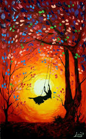 Pretty Orange On A Tree Swing Swinging Into The Golden Swirled Sunset