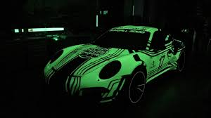 dark green porsche blackbox richter glow in the dark wrap porsche 911 motor1 com photos
