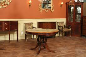 cherry finish modern round dining table with matching side chairs