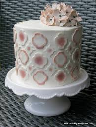 a romantic cake with handpainted decorations you cant really see