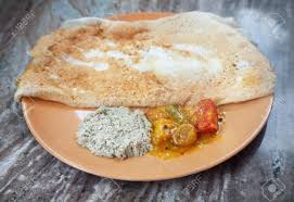 indian cuisine nearby indian traditional vegetarian masala dosa with potato inside