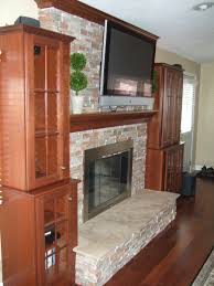 hand crafted mantel crown molding stone fireplace surround and