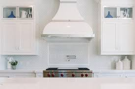 designer kitchen hoods glossy white enamel kitchen hood with gray mosaic tiles