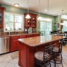 how to paint cherry wood cabinets cherry wood kitchen cabinets with aqua wall paint it