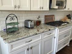 Granite Kitchen Makeovers - white tiger granite and hampton bay cognac cabinets just looking