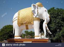 elephant statue outside a buddhist temple in burma stock photo