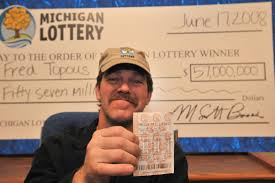 CUTLINE: Fred Topous, the latest Mega Millions jackpot winner, displays his lucky Lottery ticket. (Photo by http://www.domagalskiphotography.com, ... - 20080617-57000000MegaMillions-FredTopouslarge_238448_7