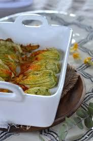 comment cuisiner les fleurs de courgettes fleurs de courgettes au four farcies à la ricotta recette