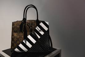 preview of louis vuitton pre fall 2016 bags in hong kong spotted louis vuitton monogram canvas with black white stripe pattern and studs city steamer bag