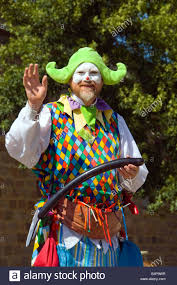 clown stilts for sale a clown on stilts performs balloon sculpturing for children at the