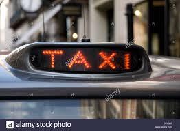 Taxi Light A Black Taxi Light On A Cab Waiting On Old Bond Street London