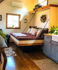 bed in the living room highland by incredible tiny homes bedroom office murphy bed and
