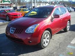 red nissan rogue venom red 2009 nissan rogue sl awd exterior photo 44775657