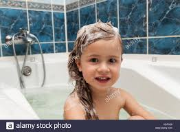 cute little washes her hair clean kid after shower children