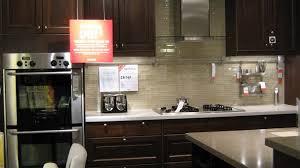 dark cabinets light backsplash glass front upper cabinet single
