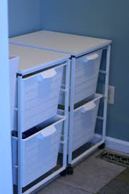 Laundry Sorter With Folding Table Small White Laundry Folding Table With Storage And Blue Wall