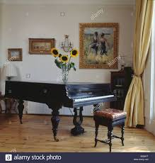 piano in living room grand piano and antique piano stool in living room with pastel