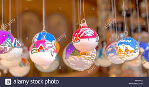glass baubles with brightly painted house motifs in snowy