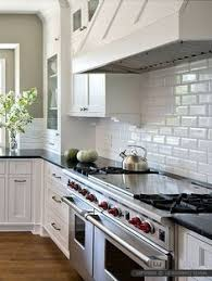 tiled kitchen ideas white kitchen cabinets with white subway tile backsplash beveled