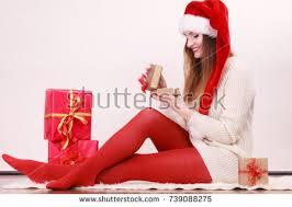 christmas small gift young woman stock photo 657987076