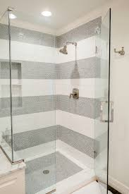 amazing shower features a marble surround alongside a white and