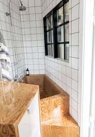 this small bathroom idea is amazing the bathtub in plywood is