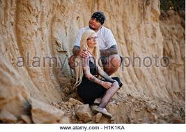tattooed couple in love background big career stock photo royalty