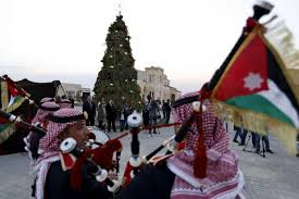 muslims and christians unite under christmas tree on site of jesus