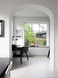 bright villa with a black fireplace coco lapine designcoco