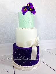 mint color and purple wedding cake with gumpaste calla lillies