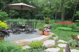 elevated bluestone patio ringed in limestone outcropping van zelst