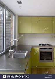 kitchen extension design stainless steel sink at uncurtained window of kitchen extension in