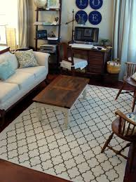 decor white quartefoil 8x10 rug with sofa and antique chairs for