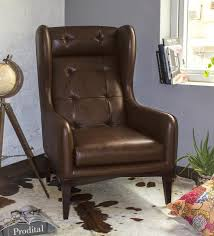 buy manhattan high back wing chair in brown colour by studio ochre
