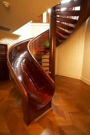 Wooden Spiral Stairs Design 10 Awesome Stairs With Slides Twistedsifter