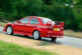 mitsubishi evo red mitsubishi lancer evo vi used car buying guide autocar