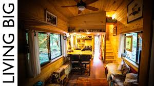 natural build tiny house for family with separate office and kids