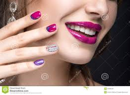 beautiful with a bright evening make up and pink manicure
