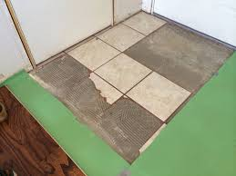 Can You Put Ceramic Tile On Concrete Basement Floor Demolition What Is The Right Way Tool To Remove This Tile And