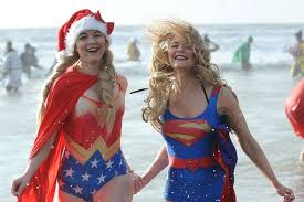 Freezing Christmas Day swim attracts record number of people as
