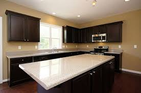 baseboards kitchen cabinets cabinets light countertops and white baseboard molding