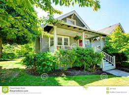 small house with porch and railings stock image