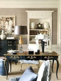 a home office furnished with white french provincial furniture